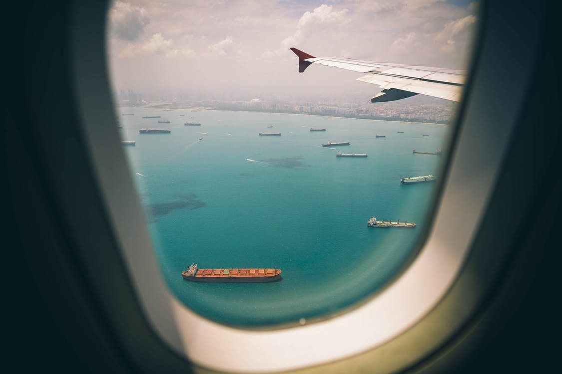 container ships seen from airplane window
